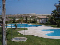 Swimming pool area of studio apartment for rent in Torrox Costa - click for details